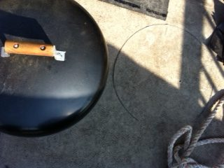 A hot grill lid burns a ring in the Duradek