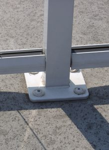 Surface mounted post with sealed penetrations